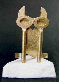 metal owl and key sculpture